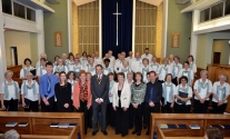 The choir with Micheila Connolly (Accompanist), The Worshipful the Mayor and Mayoress of Hillingdon, Councillor Allan Kauffman and Mrs Lynne Kauffman, Hilary Musgrave (Conductor), Janet Spotswood (Clarinet and Saxophone Soloist) and Mark Smith (Soloist Accompanist)